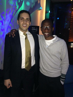 Mahbod posing with Troy Carter at the W Hotel West Beverly Hills at a party hosted by Everipedia.