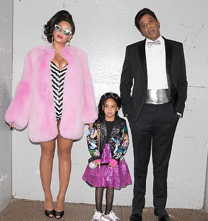 Blue Ivy dressed up as aBarbie with her parents for Halloween.
