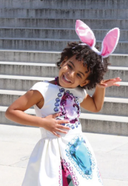 Blue Ivy with bunny ears.