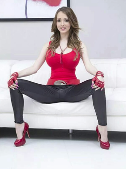 With her legs spread.