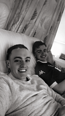 James with younger brother Luke relaxing in Oxford