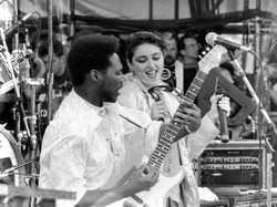 Nile Rodgers                                and Madonna performing at the 1985                                 Live Aid                                concert in Philadelphia