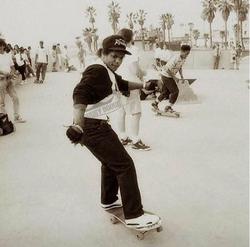 Eazy E Skateboardingdown the street inVenice, California, 1990.