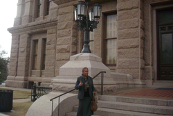 Brown outside a government building. [1]