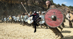 Based Stick Man leading a group of warriors