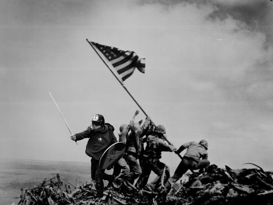 Based Stick Man provides defensive cover forUS Marines on Mt. SuribachiIwojima-1945 (tweeted picture from@Bi11TheButcher)