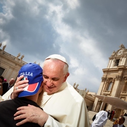 Dave Yoder's picture of Pope Francis embracing an disabled person