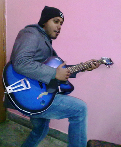 "Shikhar Srivastava performs Johnny Cash's ""Your own personal Jesus"" to a local gathering of friends and family (January 2011)."