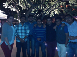 Shikhar Srivastava (center) with his ansrsource colleagues at former Target Corp CEO Bob Ulrich's party at Leela Palace, Bangalore (January 2015).