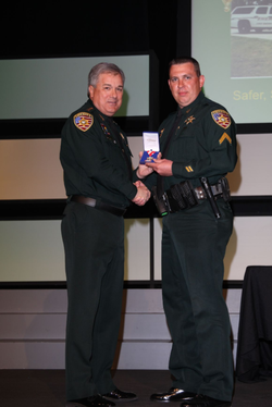 Sgt. Anderson receiving an award.
