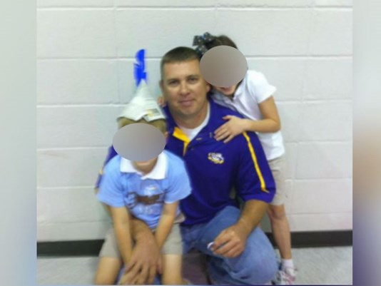 Sgt. Anderson with what could be his two children.