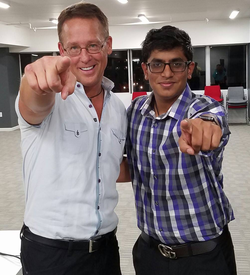 Ishan Goel takes picture with the CEO of Zig Ziglar International, Michael Ray Newman.