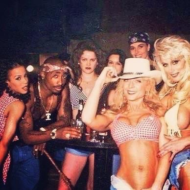"2Pac with some of the women cast in the ""How Do U Want It"" music video"
