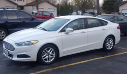 Steve Stephens' white 2013-2017Ford Fusion; it has temporary tags with the plate numberE3636330