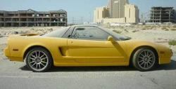 Yellow Honda NSX in the Luxury Car Graveyard in Dubai