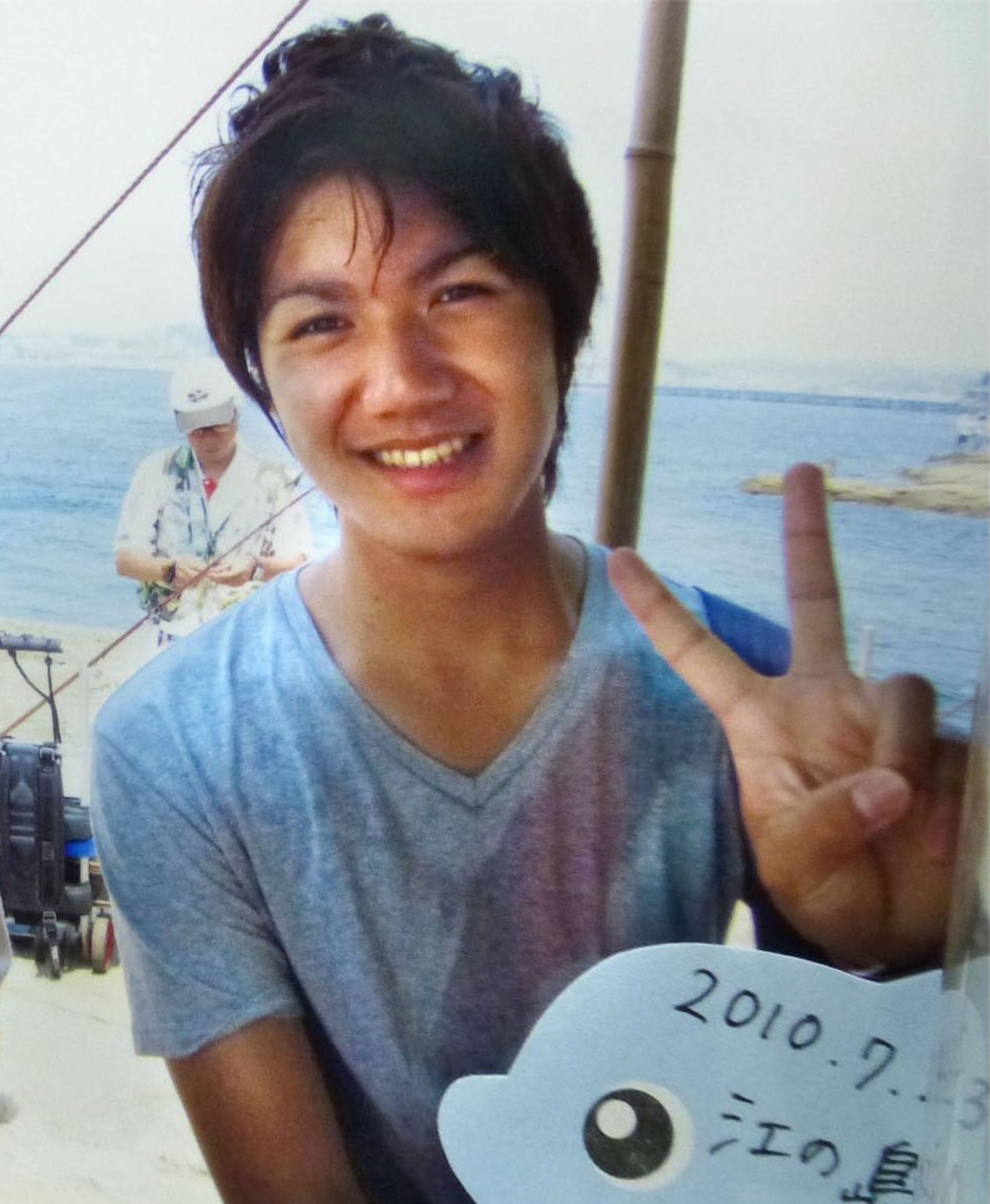 Photo of Kei when he worked as a tourist guide circa 2010.