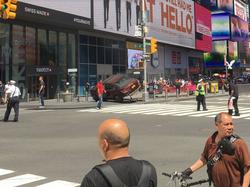 Photo of the Car crashed on the sidewalk.