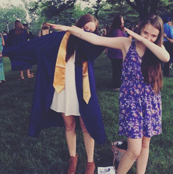 Photo of Alyssa dabbing with her sister Ava in a graduation photo[18]