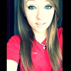 Photo of Alyssa in a red shirt[3]