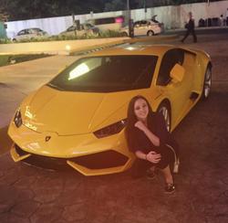 Photo of Alyssa posing next to a Lamborghini Huracán[18]
