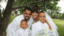 Rene on the day of his wedding with his family.