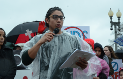 Eric speaking at a demonstration.