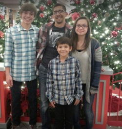 Photo of Gideon with his siblings and relatives during the Holidays.