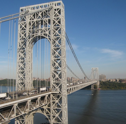 The                                 George Washington Bridge                                , connecting                                 Fort Lee                                (foreground) in                                 Bergen County                                across the                                 Hudson River                                to                                 New York City                                , is the world's busiest motor vehicle bridge.                                                   [140]                                                                                    [141]