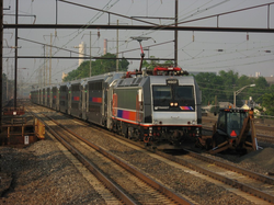 A                                 NJ Transit                                train heads down the                                 Northeast Corridor                                through                                 Rahway, New Jersey