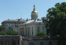 The                                 New Jersey State House                                is topped by its golden dome in                                 Trenton                                .