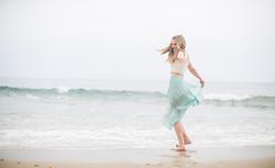 Kathy on a beach