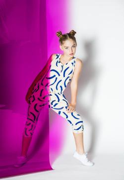 Jade Weber modeling for                               Hooligans Magazine                              (purple & white)