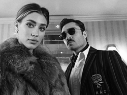 Black and white photo of Jessica Serfaty with Ed Westwick​.