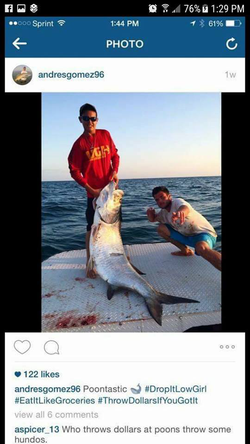 Wenzel and a friend with a Tarpon​ they caught and killed illegally