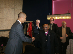 Yannick shaking hands with Desmond Tutu​