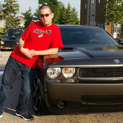 James next to his  Dodge Challenger  ​