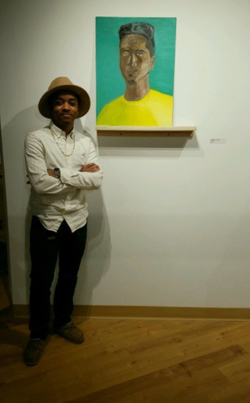 Droxity posing with his painting at (Scene) Metrospace.