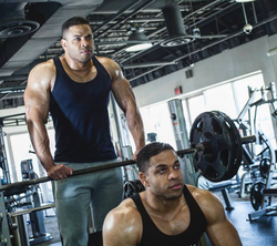 Hodge Twins at the bench press section of a gym