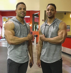 Hodge Twins flexing their arms at a gym
