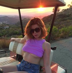 Riding a golf cart