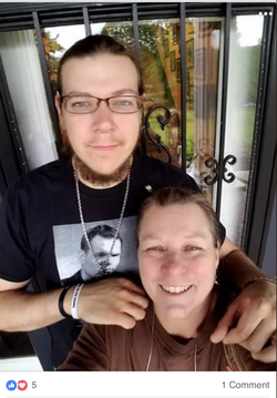 Photo of Jacob Scott Goodwin with his mother.