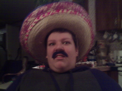 Jacob Scott Goodwin photo of wearing a sombrero and fake mustache.