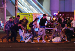 People being assisted in the aftermath of the shooting