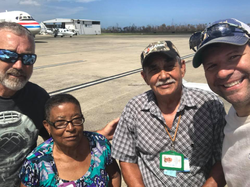Photo of Julio Canales and a friend helping an elderly couple inVieques, Puerto Rico[2]