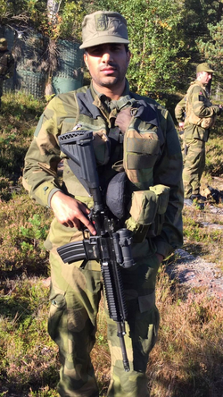 Suchet in the Norwegian Home Guard with a Heckler & Koch 416