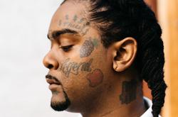 03 Greedo                              profile photo that presents his tattoos.