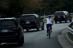 The photo of Juli flipping of the presidential motorcade
