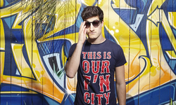 Seigal wearing a 'This Is Our F'n City' shirt