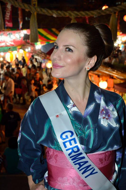 Aline Marie Massel wearing a                               kimono                              ​ at the                               Miss International 2012                              ​ pageant after winning the                               Miss International Germany                              pageant