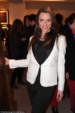 Aline Marie Massel wearing a suit